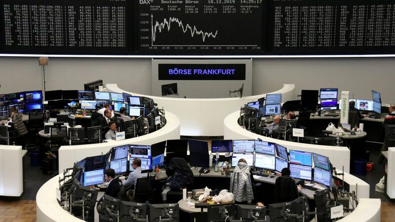 European shares hover near record high in thin holiday trade