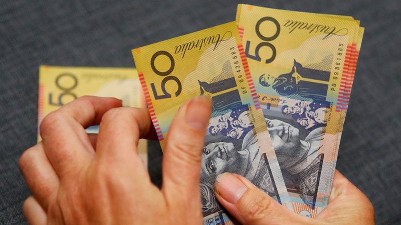 Aussie dollar near six-week peak as easing lockdowns spur risk