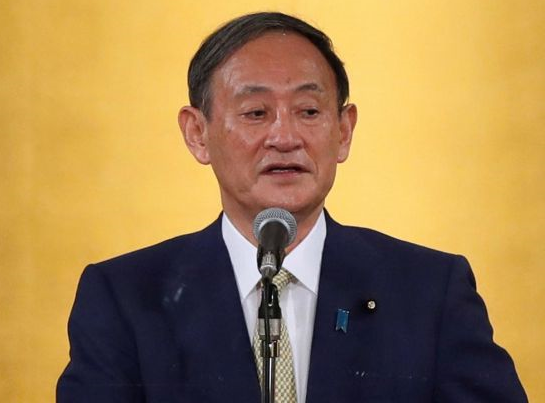 Japan's Yoshihide Suga wins ruling party race to replace premier Shinzo Abe